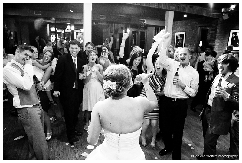 """In the interest of full disclosure, this was NOT a karaoke wedding reception, but the bride totally rocked out with the band on Journey's """"Don't Stop Believin'"""" and this is one of our favorite reception shots. Ever."""