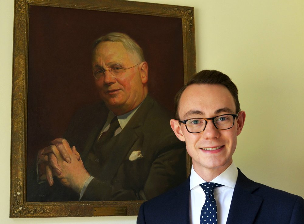 Nicholas Bowman-Scargill with a portrait of his great-grandfather, the last member of the family who ran the original family business    Photo: Fears Watches