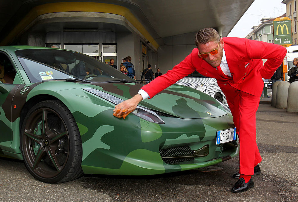 Lapo and his Ferrari red suit...and sunglasses, tie, and socks  Photo by Marco Luzzani/Getty Images Entertainment / Getty Images