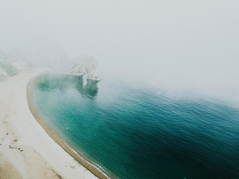 durdle door morning fog