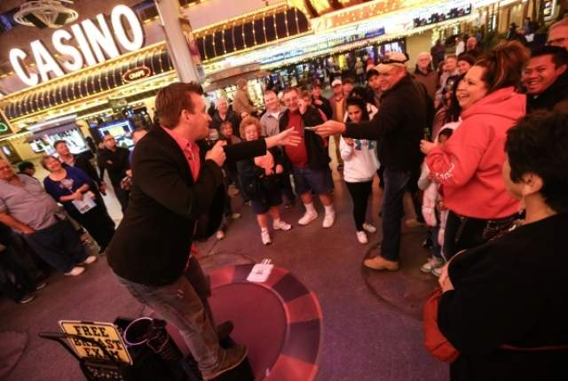 Street magician, chris Randall, Holding court at the Fremont Experience