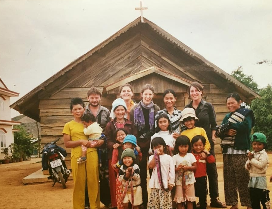 1999 - Coffee production grew significantly during the 1990's. As tourism in the area increased, Rolan Colieng (center) took the opportunity to start a family business selling locally made handicraft weavings from her community.