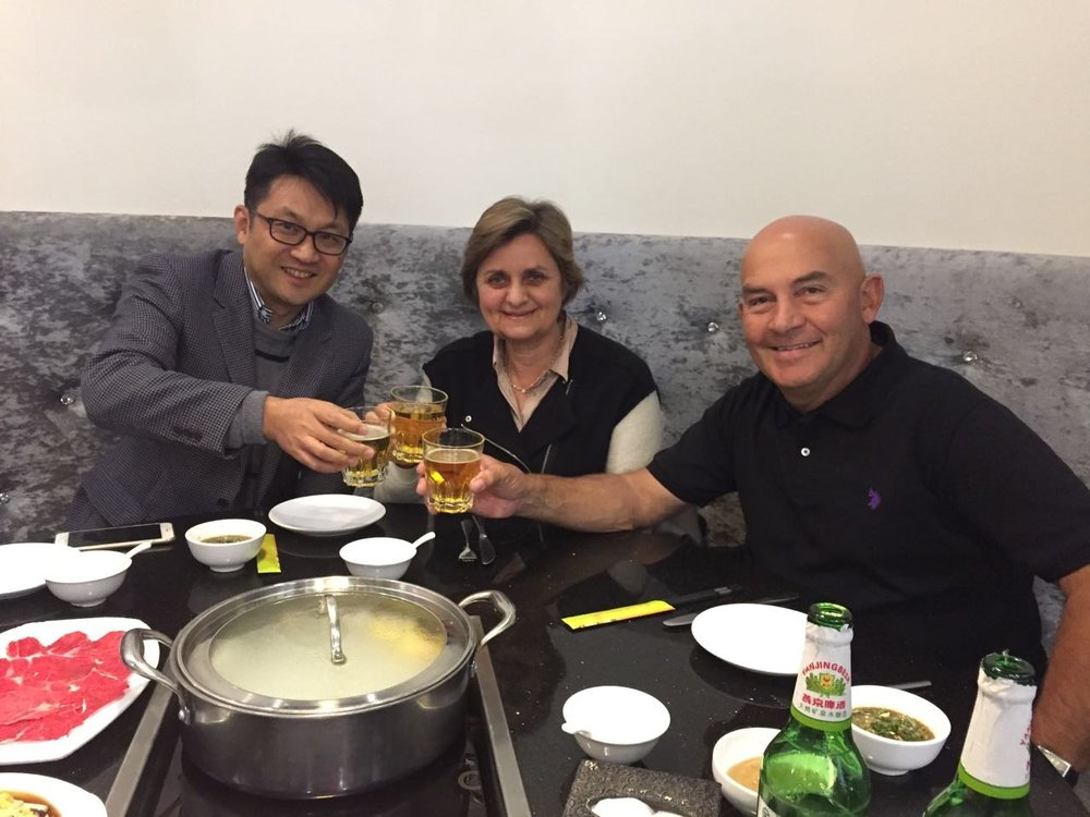 Ernst and Gwenda sharing a hot pot with our importer, Michael from Jiangxi Imports in China.