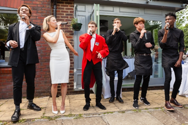Our singing waiters, toastmaster and guests flash mobbed this beautiful wedding in June