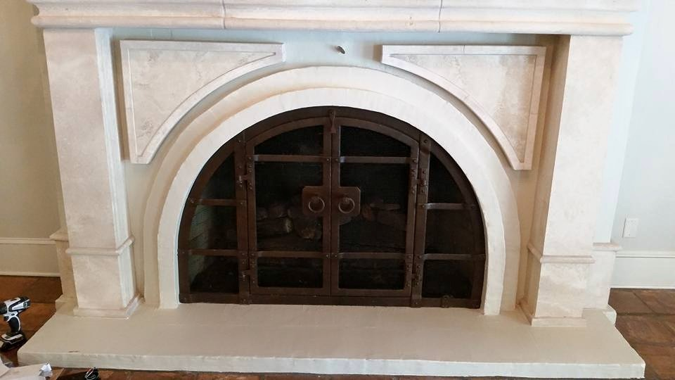 Custom arched fireplace doors.   Lafayette, Louisiana