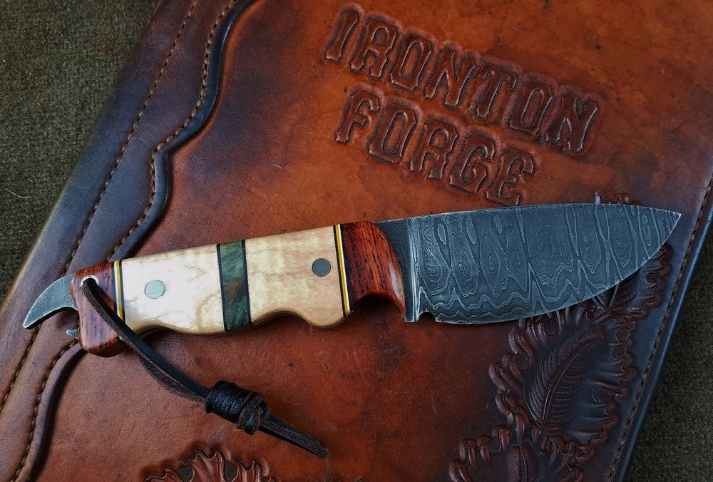 Damascus knife w/ bottle opener