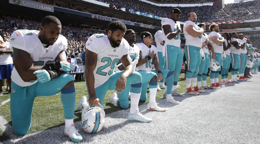 arian-foster-dolphins-national-anthem-kneel.jpg