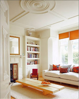 fisher+hart+photography+london+hampstead+living+room+white+walls+furniture+orange+accents+panel+ceiling+medallion+modern+built+in+bookshelf.jpg