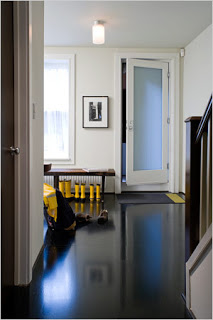 black+floor+with+yellow+accents+and+black+handrail.jpg