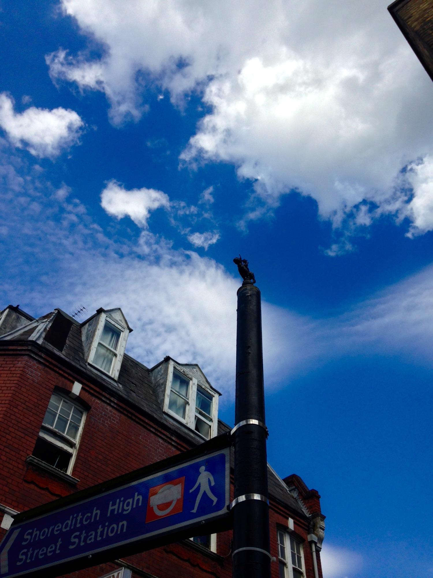 Photo 2: piece by Jonesy on Shoreditch High Street Station sign post