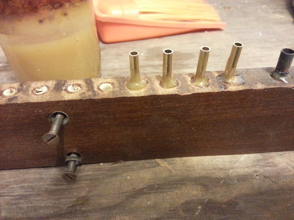 Spin the connector into the pouch board to create a collar of burnt shellac.