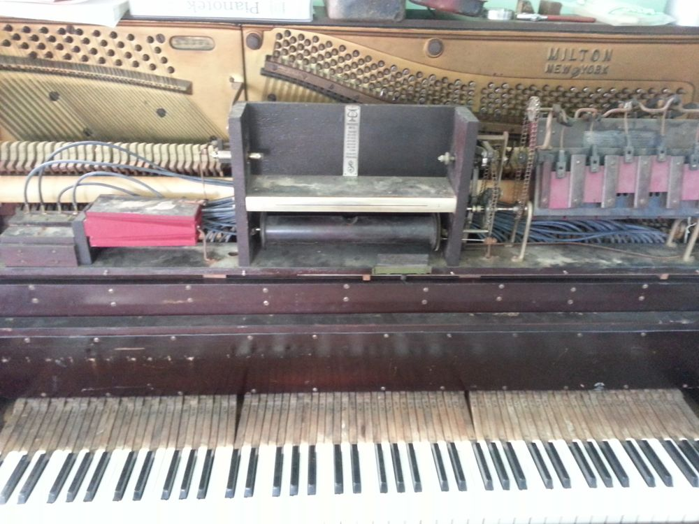 The upper stack of a player piano after replacing the lead tubing with new rubber tubing.