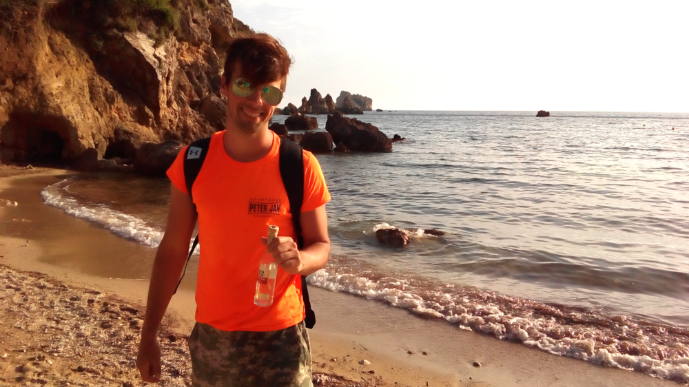 Marcio and his Ouzo. Greek beach style. Keepin' it real :P