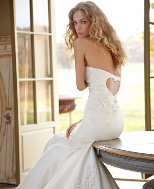 A heart shaped key hole adds a Valentine's Day touch to this beautiful wedding gown