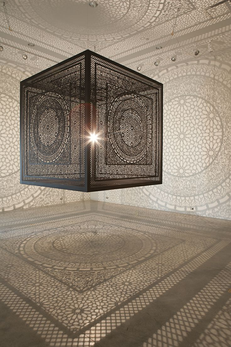 Intersections: An Ornately Carved Wood Cube Projects Shadows onto Gallery Walls