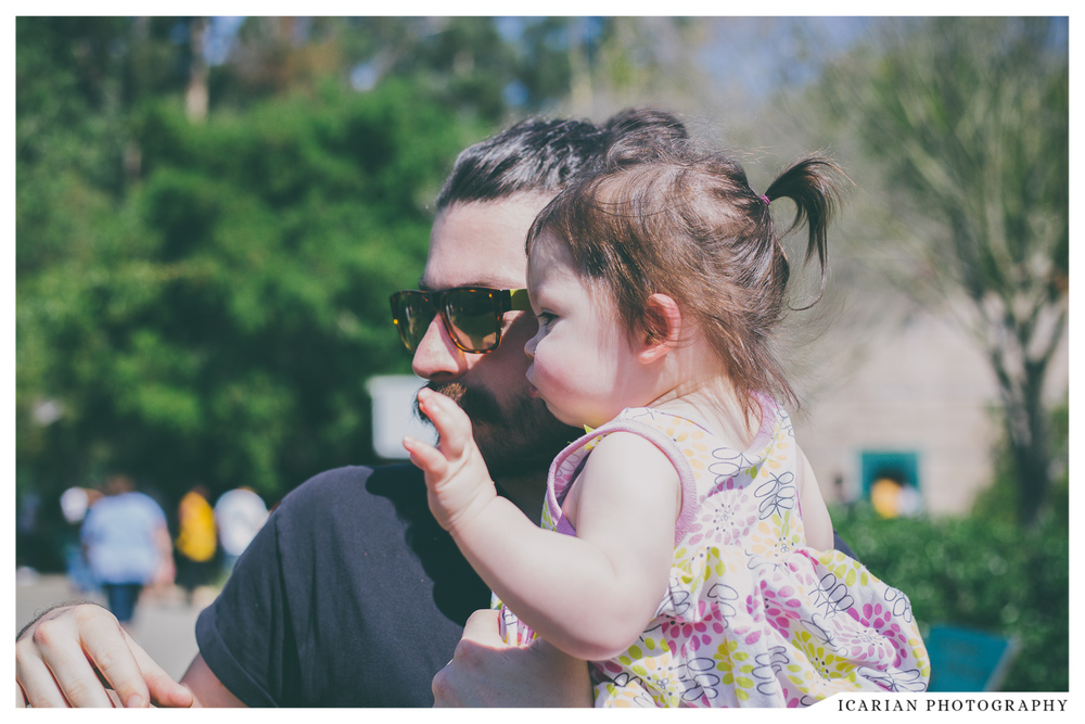 "We went to the Oakland Zoo a couple weeks ago, Vee. Here you are, in your cute pony tail, with daddy, waving ""hi"" to the hog."