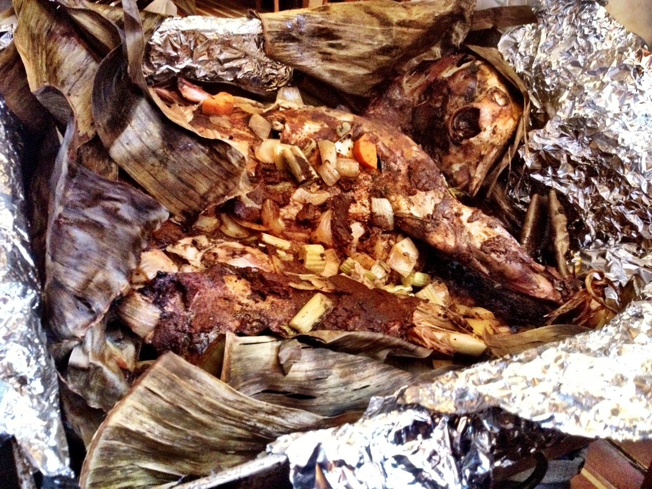 Whole Roasted Goat wrapped in banana leaf and slow roasted 6 hours. This may be our Sunday special.