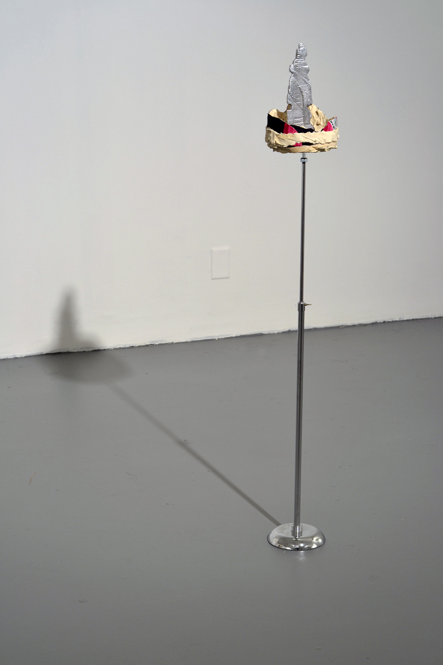 "Modern Voodoo #3- G, E, B, M, K, N Eknæs Tower , 2013    cast aluminum, latex, fabric, stainless steel display stand    7.5"" X 50.5"" / 19 cm x 128.5 cm"