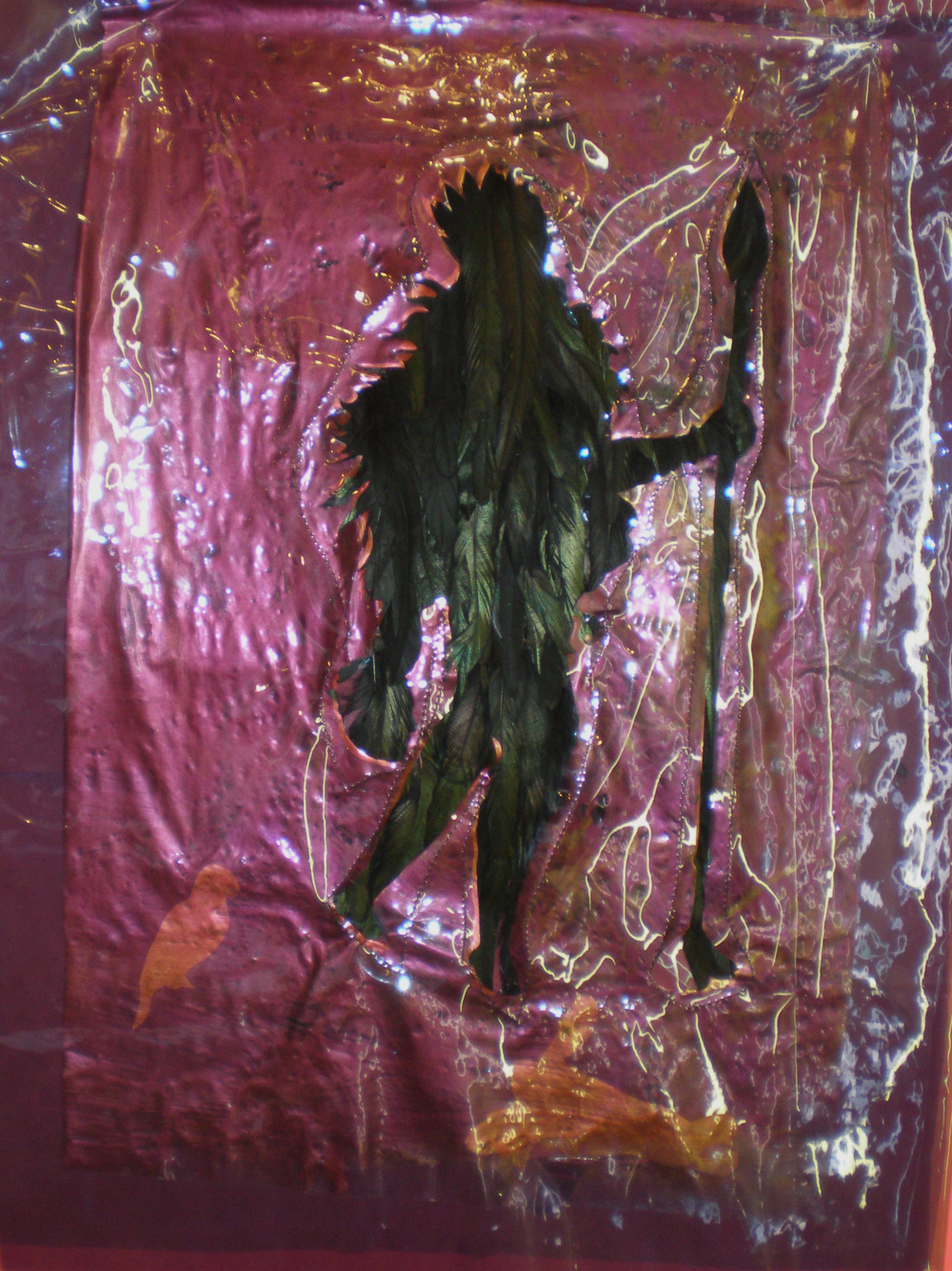 "Allegory of America Carrying Decapitated Head , 2007  vinyl, paint, rooster feathers  32"" x 24"""