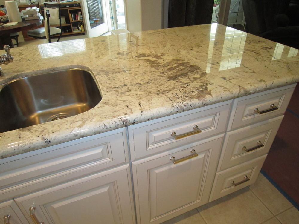 Nice White Cabinet Island With White Granite Countertops In Upland, California