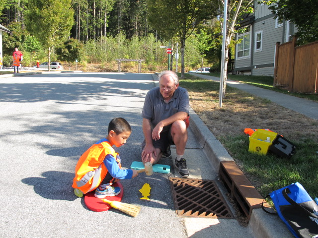 Scouts mark storm drains - Sept 23, 2017Scout group with members Susan and Terry marked storm drains in Coquitlam.