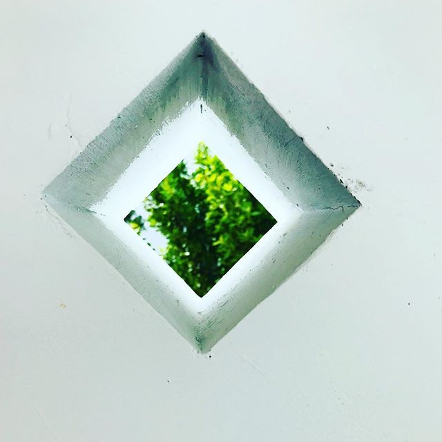 "Beautiful ""sneak peak"" through a concrete wall into the courtyard of a new home by @moorbakerarchitects"