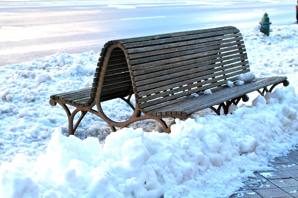 Lonely bench with snow