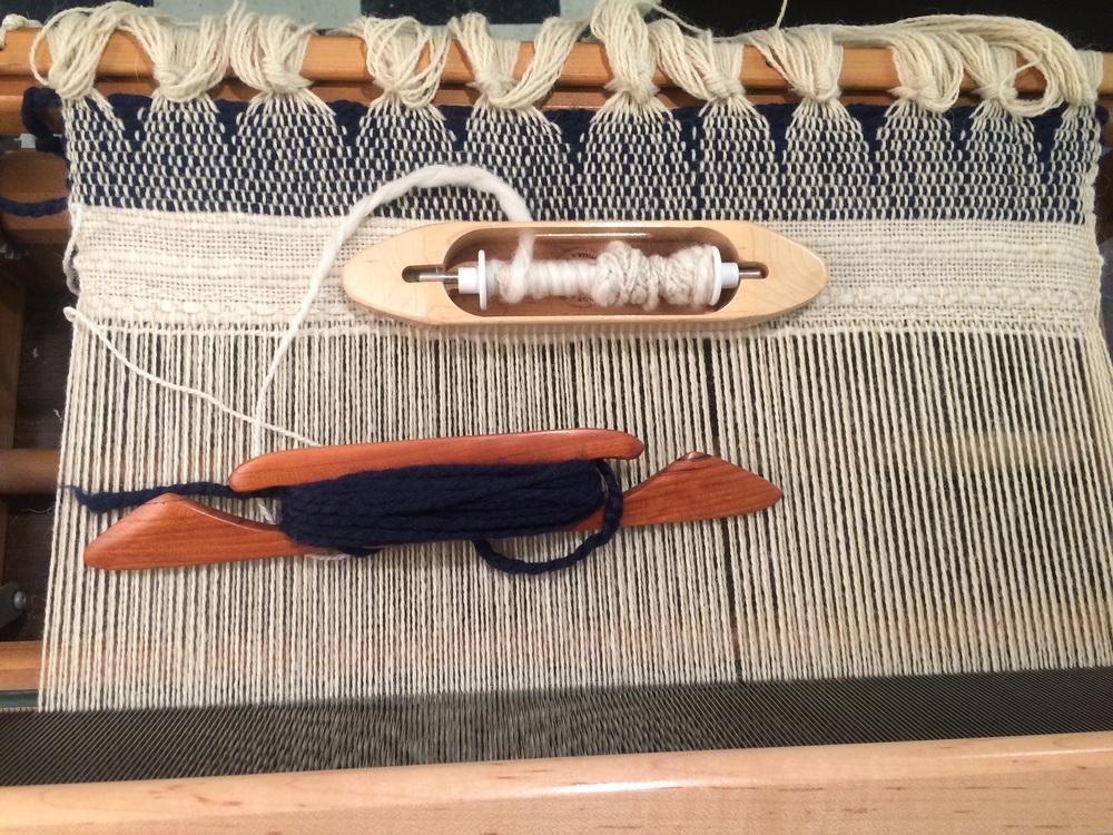 Shuttles of thread ready for weaving.
