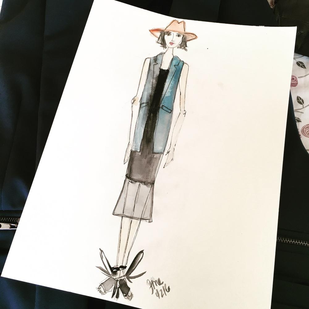 Blue sleeveless blazer and black dress