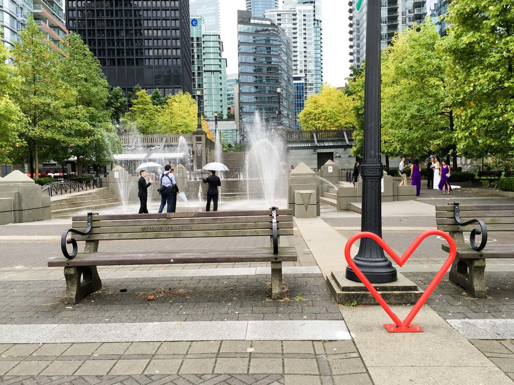 Heart-shaped bike rack and a wedding party caught in the rain near the waterfront on the north side of downtown Vancouver. More photos from my trip on  my flickr album .