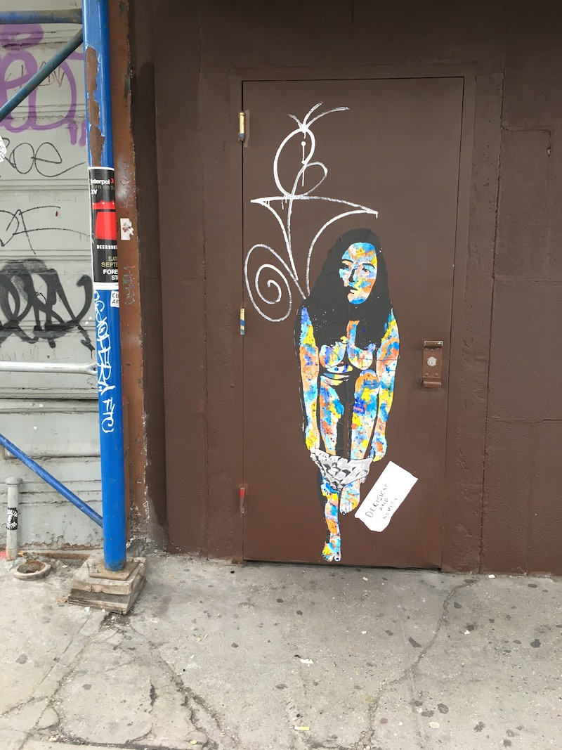 Street art on door in LES.