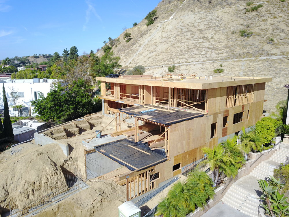 3 level, 8,000 sq ft Custom Home, perched in the hills of Grifith Park.  Subterranean garage and basement, and 2 floors overlooking the Los Angeles Skyline.
