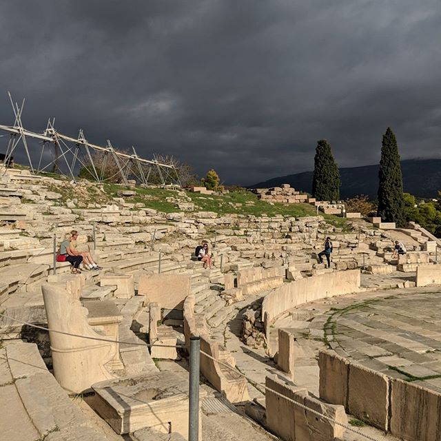 "OMG look at those clouds?!?⛈ Athens 🇬🇷on the way up to the top of the Parthenon on our very last full day in Greece.  I remember sitting there on the steps thinking ""how was this theatre possibly built 2K years ago?"" and pondering that a bit more before Nick called out to keep climbing!  A refreshed perspective I took on that day was how strange and wonderful our world is and how the little things in our heads are really just in our heads. It's a simple reminder that stuck with me since I've been home and this is a nudge if you need that simple reminder today too. 👊  #athens #perspective #mindsetiseverything #greece #nikkyberleenaitaliagreece"