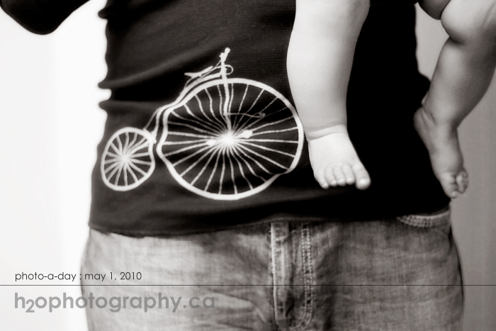 may1 photo of the day baby legs and bicycle shirt and jeans
