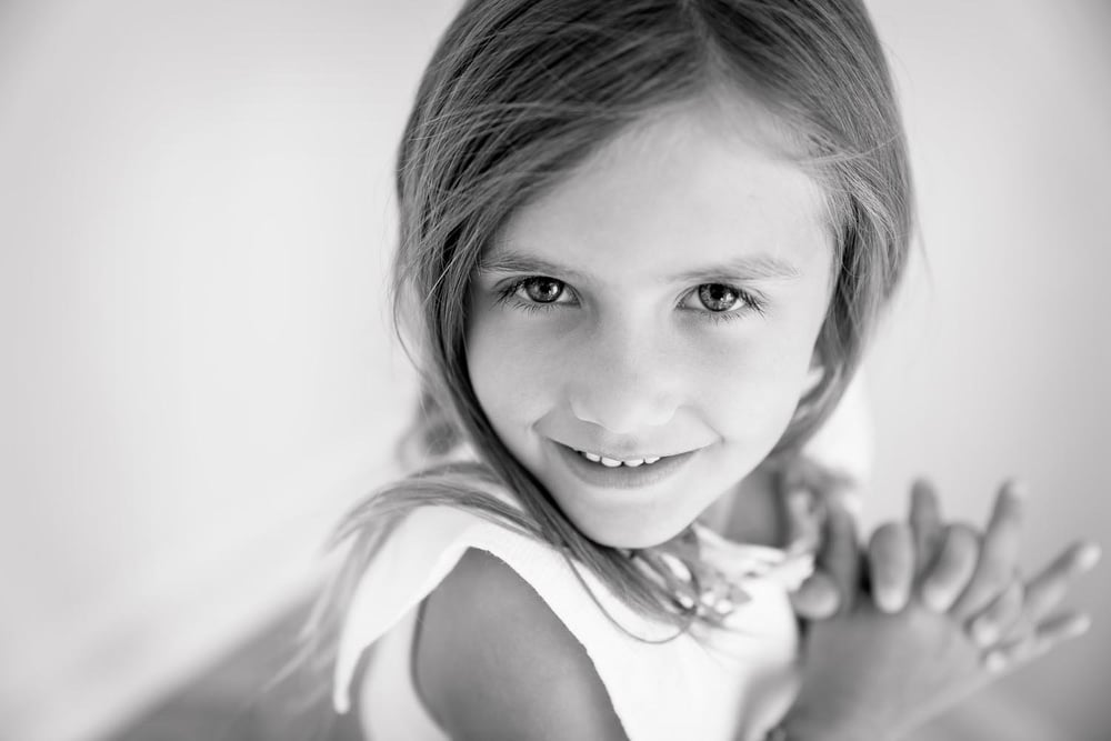 sweet-little-girl-smiling-with-sass-toronto-child-photography