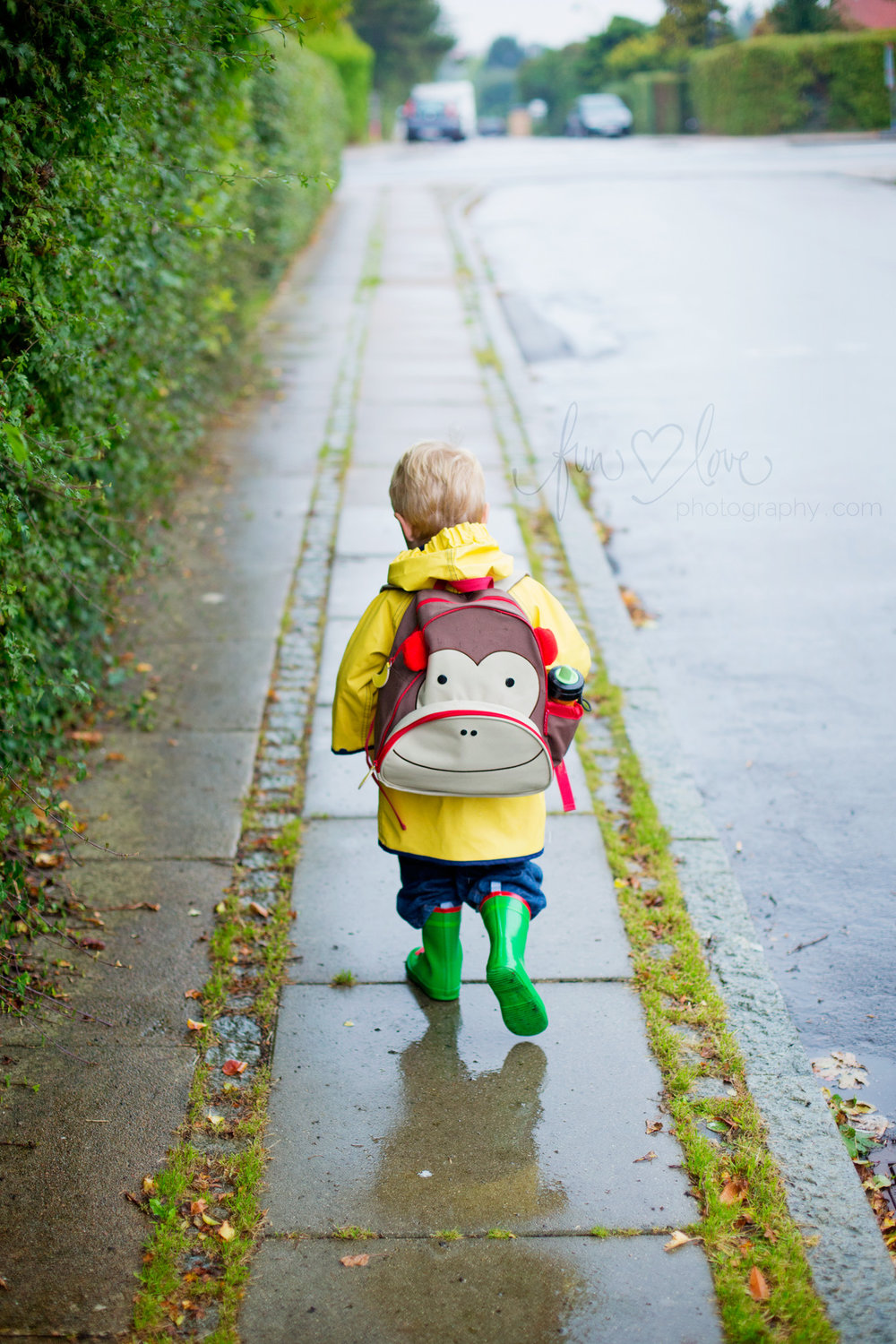 Heading to school, backpack on.