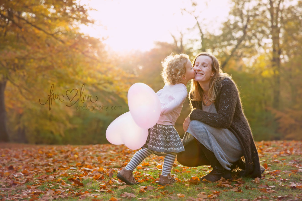 girl and mom beautiful backlit fall scene
