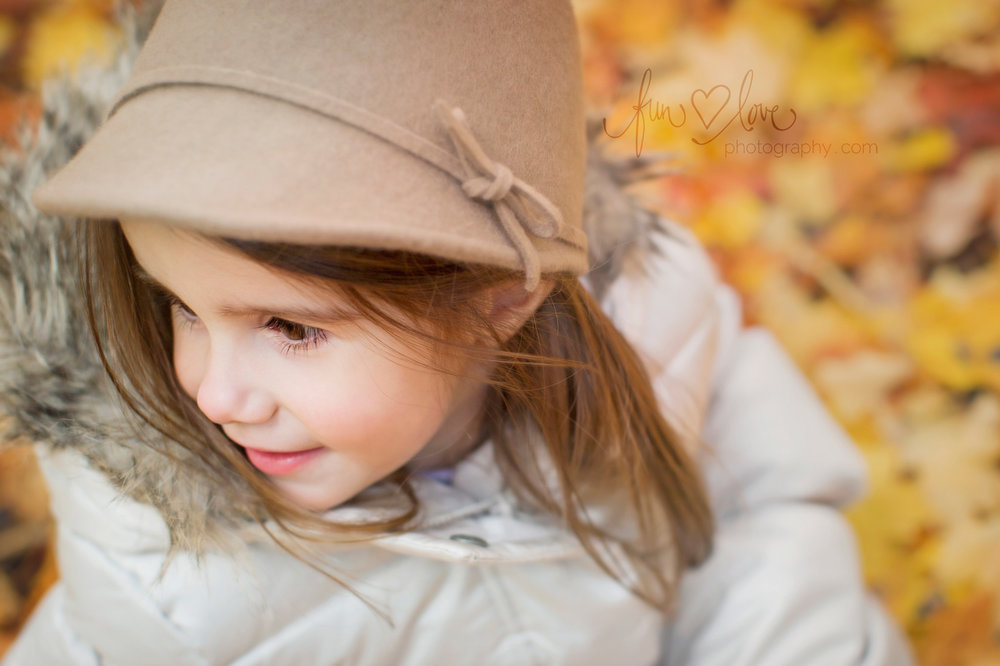 girl in felt hat and jacket in the fall leaves