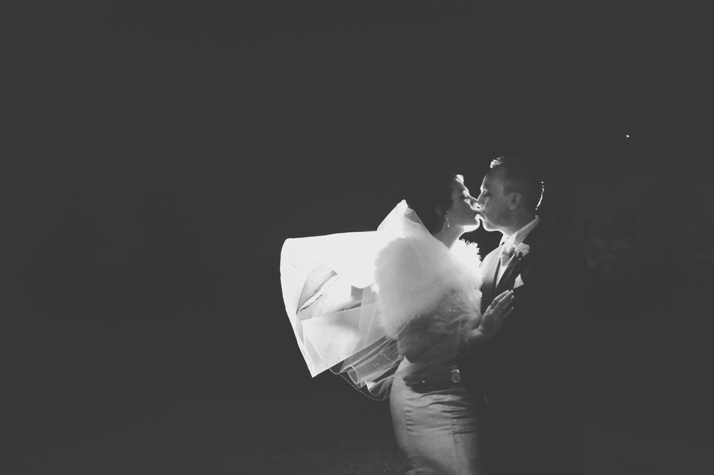 Three Flowers Photography Essex Wedding Backlit Night Bride and Groom Veil Portrait