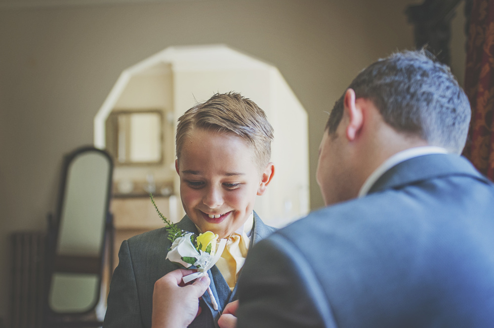 Three Flowers Photography Suffolk Country House Wedding Page Boy Corsage