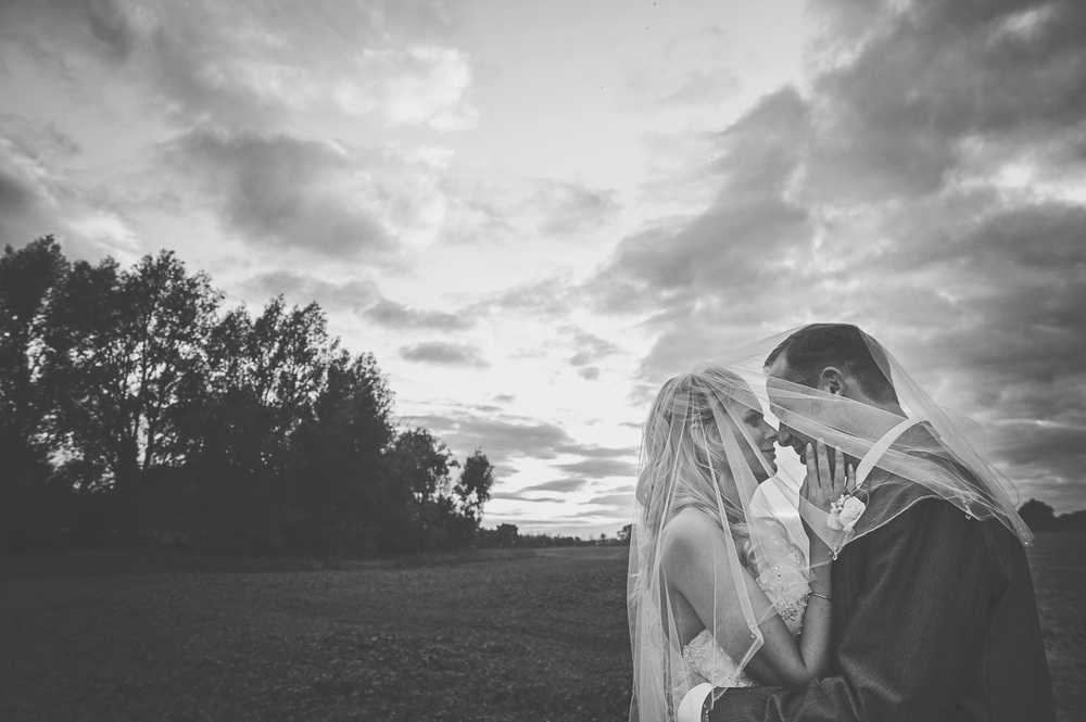 Three Flowers Photography Suffolk Wedding Sunset Bride & Groom veil shot