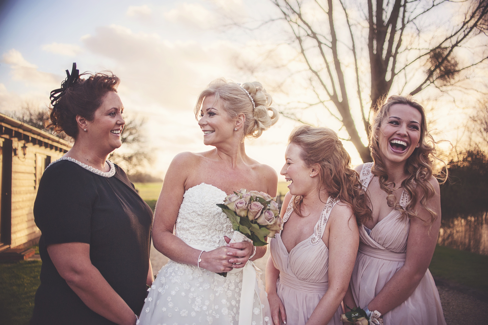 Three Flowers Photography Essex Barn Wedding Bride and Bridesmaids