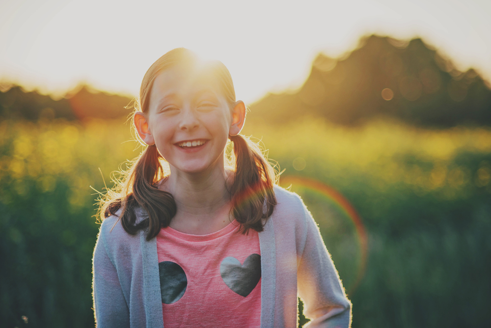 Young girl laughs in sunset Essex Documentary and Lifestyle Portrait Photographer