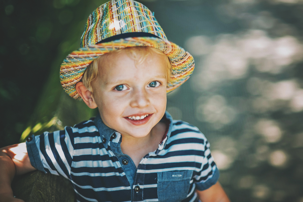Little boy in sun hat Essex Documentary and Lifestyle Portrait Photographer
