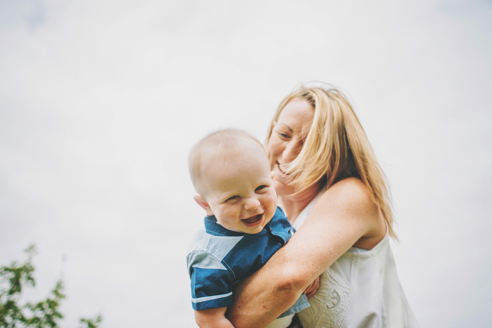 Mum holds giggling baby boy Essex Documentary and Lifestyle Portrait Photographer