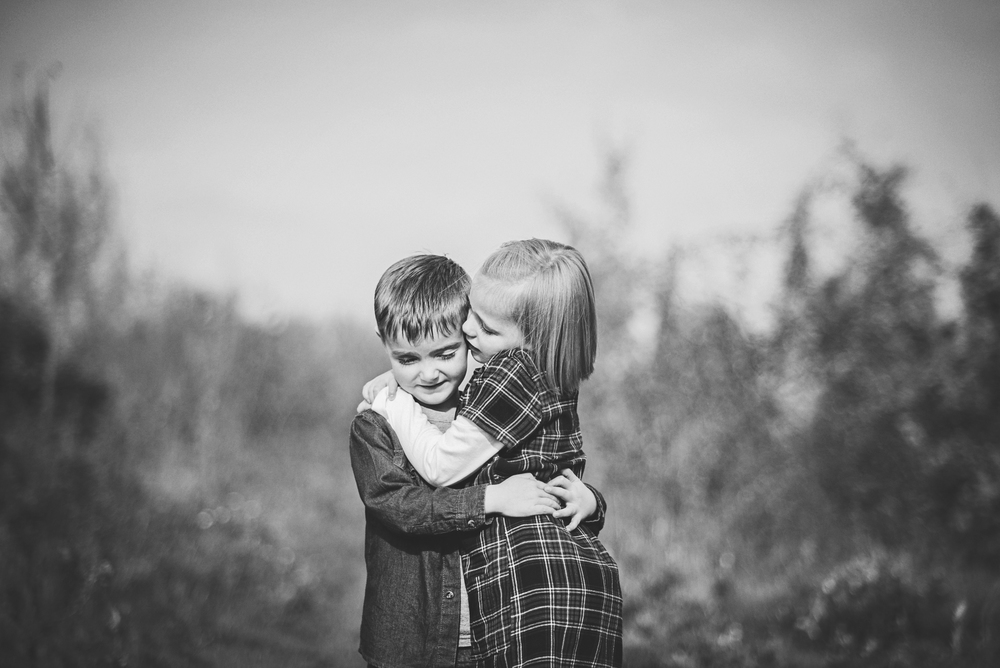 Brother and sister hug Essex Documentary and Lifestyle Portrait Photographer