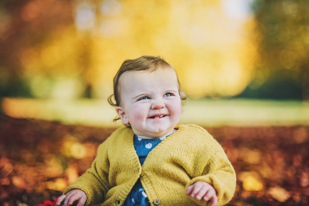 Cute baby girl in park in Autumn Essex Documentary and Lifestyle Portrait Photographer