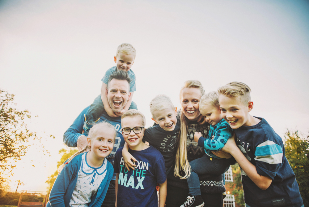 Big family cuddle at sunset Essex Documentary and Lifestyle Portrait Photographer
