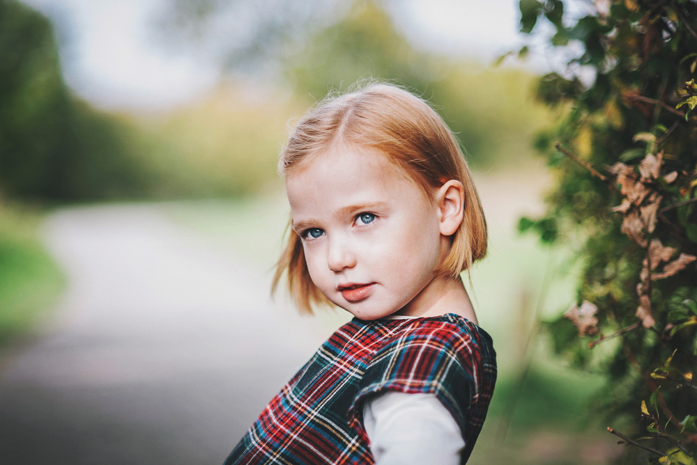 Little girl in tartan dress Essex Documentary and Lifestyle Portrait Photographer