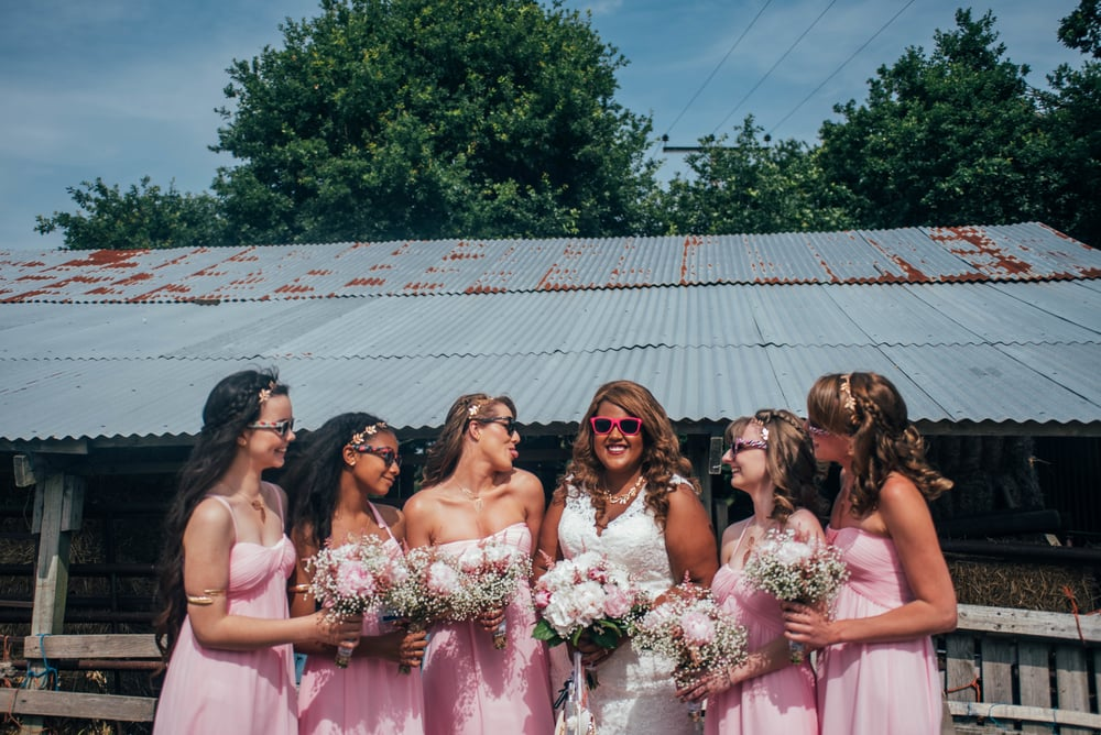 Bride and Bridesmaids sunglasses Festival wedding Essex UK Documentary Wedding Photographer